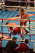 Mirzet Bajrektarevic hits the ropes after a stomach punch by Martin murray during the High Stakes Matchroom Boxing at the Manchester Arena, Manchester, United Kingdom on 18 July 2015. Photo by Mark Pollitt.