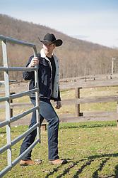 hot cowboy on a ranch closing a gate