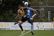 Joel Stevens (Wellington) and Tom Biss clash. Team Wellington v Hawkes Bay United, ASB Premiership semi final at David Farrington Park, Wellington. 8 March 2014. Photo: Cameron McIntosh/www.photosport.co.nz