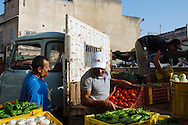 Vendors unload produce in Bizerte, Tunisia. Bizerte is the northernmost city in Africa.