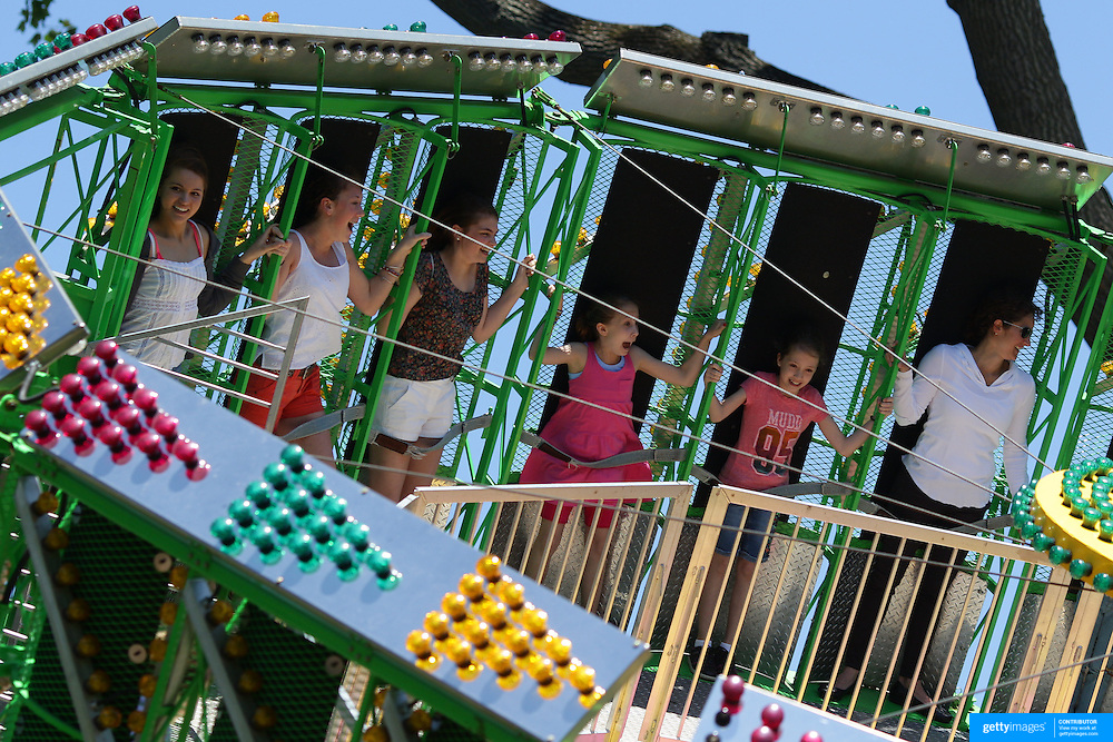 Adults teenager and children alike enjoy the fun rides during the May Fair at Saint Mark's Church, New Canaan, Connecticut, USA. 12th May 2012. Photo Tim Clayton