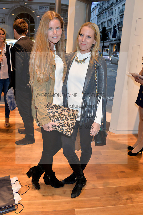Left to right, KATIE READMAN and ALICE NAYLOR-LEYLAND at a party to celebrate the 30th Anniversary of the Breitling Chronomat held at 130 Breitling, New Bond Street, London on 7th May 2014.