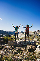 Above it all. Backpackers Alexa Ault and Kevin Luby soak up the view of Stough Creek Basin, Wind River Range, Wyoming.
