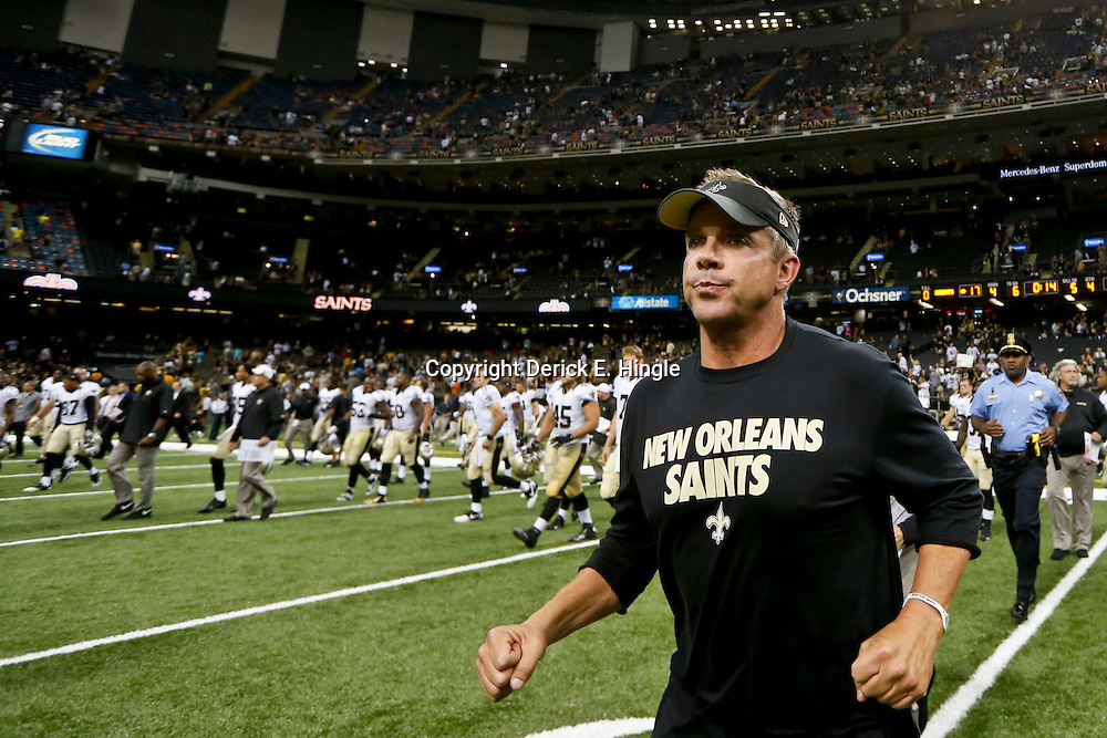 Aug 9, 2013; New Orleans, LA, USA; New Orleans Saints head coach Sean Payton runs to midfield following a win against the Kansas City Chiefs in a preseason game at the Mercedes-Benz Superdome. Mandatory Credit: Derick E. Hingle-USA TODAY Sports
