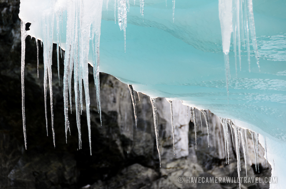 Long icicles hang off the edge of an iceberg in Cierva Cove in Antarctica.
