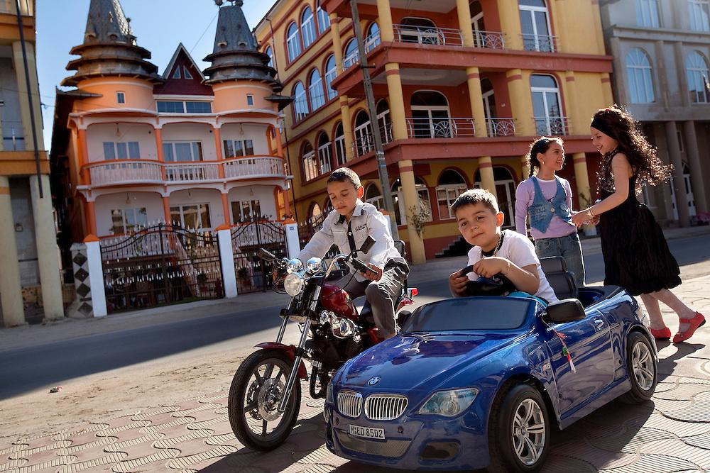Armani Maih, Canti Maih, Amalia Scare, Zaharia Ghita play on the main street of Buzescu, a small town in Romania.