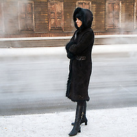 A lady waits for her ride on a cold Irkutsk morning.