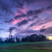Sunset sky over cell tower in Littleton, MA
