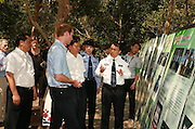 XISHUANGBANNA, CHINA - MARCH 04: (CHINA OUT) <br /> <br /> The Duke Of Cambridge Visits Yunnan's Xishuangbanna<br /> <br /> Chief of Xiashuangbanna Forest Public Security Bureau Wang Chao (R) introduces local forestry to Prince William, Duke of Cambridge, during his visit Dai Autonomous Prefecture of Xishuangbanna/Sipsongpanna on March 4, 2015 in Xishuangbanna, Yunnan province of China. The Duke of Cambridge is on a four-day visit to China. He is the first senior British royal to visit China since the Queen and Prince Philip visited in 1986.<br /> ©Exclusivepix Media