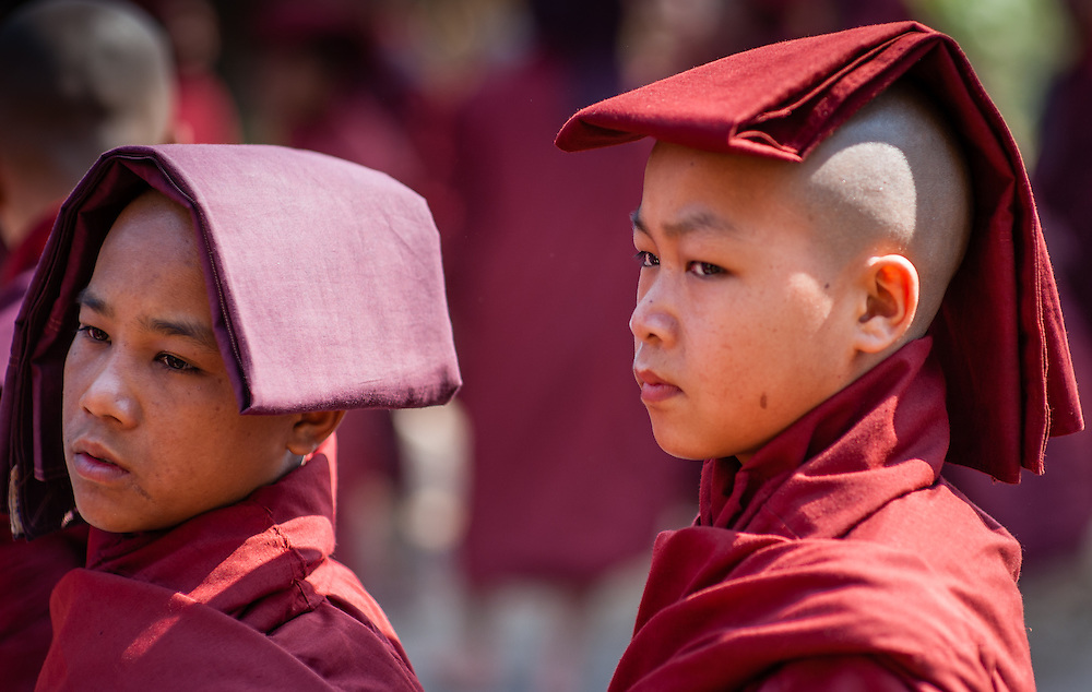 Young Buddhist monks protecting themselves from the sun (Myanmar)