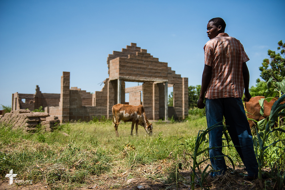 A farmer watches over his animals adjacent to a Lutheran church under construction in Usanda, Tanzania, on Saturday, March 14, 2015. LCMS Communications/Erik M. Lunsford