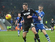 Yanic Wildshut, Scott Tanser during the Sky Bet League 1 match between Rochdale and Wigan Athletic at Spotland, Rochdale, England on 14 November 2015. Photo by Daniel Youngs.