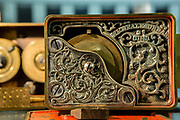 A lock with filigree decoration in  the John M. Mossman Lock Collection at the General Society of Mechanics & Tradesmen of the City of New York.