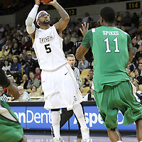 Central Florida guard Marcus Jordan (5) shoots over Marshall center Nigel Spikes (11) during a Conference USA NCAA basketball game between the Marshall Thundering Herd and the Central Florida Knights at the UCF Arena on January 5, 2011 in Orlando, Florida. Central Florida won the game 65-58 and extended their record to 14-0.  (AP Photo/Alex Menendez)