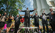 Dr. Dexter Easley preaches to a crowd gathered outside the Emanuel AME Church during a prayer service by the National Clergy Council, Saturday, June 20, 2015  in Charleston, S.C. Clergy from around the country led prayers and words of hope to the people in attendance. (AP Photo/Stephen B. Morton)