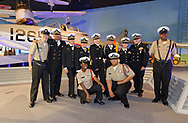 Garden City, New York, U.S. June 6, 2019. Freeport High School Navy Junior ROTC cadets wearing uniforms and about to participate at Apollo at 50 Anniversary Dinner at Cradle of Aviation Museum, pose for photo in front of historic aircraft at museum exhibit.