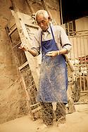 old man mending nets