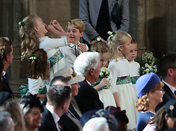 The bridesmaids and page boys, inclduing Prince George and Princess Charlotte, arrive for the wedding of Princess Eugenie to Jack Brooksbank at St George's Chapel in Windsor Castle.
