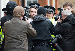 © London News Pictures. 23/04/2012. Feltham, UK. Trenton Oldfield (centre) surrounded by police and photographers as he leaves Feltham Magistrates' Court in West London, where he faced charges under the Public Order Act after he allegedly swam out into the Thames during the The boat race between Oxford and Cambridge. The incident forced the boats to stop and re-start from the halfway point. Photo credit : Ben Cawthra /LNP