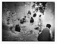 A larger group of men gather together inside abandoned garden to smoke heroin in the old city of Kabul, Afghanistan.  There are 40,000 - 50,000 heroin and opium users in Kabul, says Dr. Qureshi, Deputy Director of  Kabul's only gov?t run mental hospital, Psychiatric and Drug Dependency Hospital, Kabul.