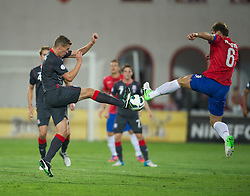 NOVI SAD, SERBIA - Tuesday, September 11, 2012: Wales' Steve Morison in action against Serbia's captain Branislav Ivanovic during the 2014 FIFA World Cup Brazil Qualifying Group A match at the Karadorde Stadium. (Pic by David Rawcliffe/Propaganda)