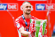 Patrick Bauer of Charlton Athletic (5) with the play off trophy, after scoring the last second winning goal, during the EFL Sky Bet League 1 play off final match between Charlton Athletic and Sunderland at Wembley Stadium, London, England on 26 May 2019.