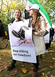 "35559258© Licensed to London News Pictures. 29/10/2011. London, UK.  Two girls carry a banner on the march. Amnesty International join Syrians in the UK for a ""N0 More Blood - No More Fear"" march and rally in Paddington Green, London, today 29th October 2011. Activists claim  Syrian security forces opened fire on Friday on protesters and hunted them down in house-to-house raids, killing about 40 people in the deadliest day in weeks in the country's 7-month-old uprising. Photo: Stephen Simpson/LNP"