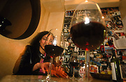Girl with glasses of red wine at a wine bar