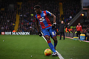 Wilf Zaha on the ball during the Barclays Premier League match between Crystal Palace and Southampton at Selhurst Park, London, England on 12 December 2015. Photo by Michael Hulf.