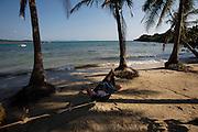 Phu Quoc Island. Bai Cua Can. Tourist in hammock.