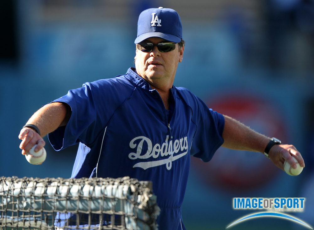 Aug 2, 2010; Los Angeles, CA, USA; Los Angeles Dodgers pitching coach Rick Honeycutt (40) throws during batting practice before the game against the San Diego Padres at Dodger Stadium. Photo by Image of Sport