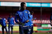 Koby Arthur of Macclesfield Town reads todays program during the EFL Sky Bet League 2 match between Crawley Town and Macclesfield Town at The People's Pension Stadium, Crawley, England on 23 February 2019.