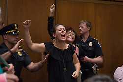 September 6, 2018 - Washington, District of Columbia, U.S - Protestors disrupt U.S. Supreme Court nominee Judge Brett Kavanaugh's confirmation hearing on Capitol Hill. Kavanaugh was nominated by U.S. President Donald Trump to fill the vacancy on the court left by retiring Justice Anthony Kennedy. (Credit Image: © Erin Scott/ZUMA Wire)