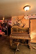 Marfa, Texas, Lost Horse Saloon, antique piano, deer head mount
