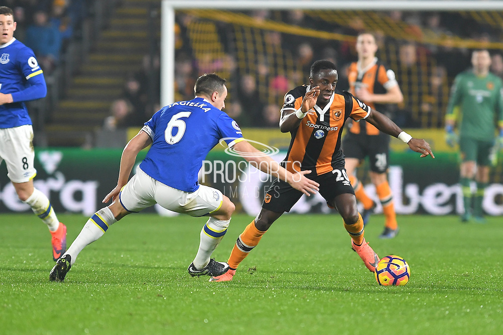 Hull City Striker Adama Diomande (20) under attack from Phil Jagielka (6) Everton FC defender during the Premier League match between Hull City and Everton at the KCOM Stadium, Kingston upon Hull, England on 30 December 2016. Photo by Ian Lyall.