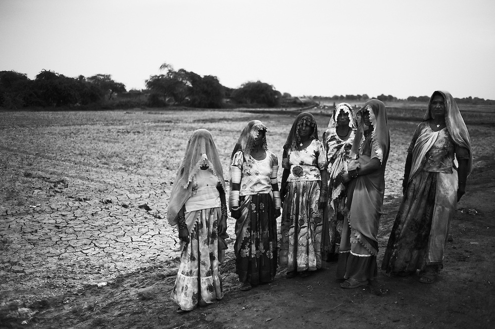 Displaced flood victims, hindu women stand alongside a road in Mirpur Khas district, Sindh, Pakistan on November 3, 2011. In August 2011, Heavy monsoon rains triggered flooding in lower parts of Sindh and northern parts of Punjab.