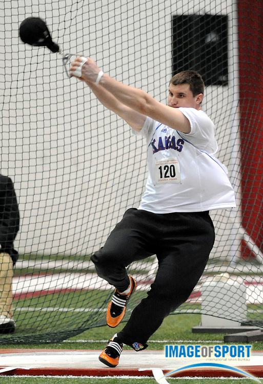 Mar 15, 2008; Fayetteville, AR, USA; Egor Agafonov of Kansas won the weight throw at 74-6 1/4 (22.71m) in the NCAA indoor track and field championships at the Randal Tyson Center.
