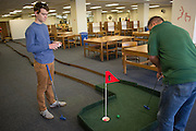Davis Sullivan, a senior, left, plays mini golf with his dad Sean Sullivan, of Dayton Ohio, in Alden Library during Dad's Weekend on November 5, 2016.