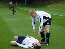 Conservative MPs Gavin Barwell (on the ground ) and  Dr.Philip Lee MP for Bracknell. The Press v Conservatives football match, played on the second day of the Conservative Conference, Manchester, United Kingdom, Monday, 30  September 2013. Picture by i-Images