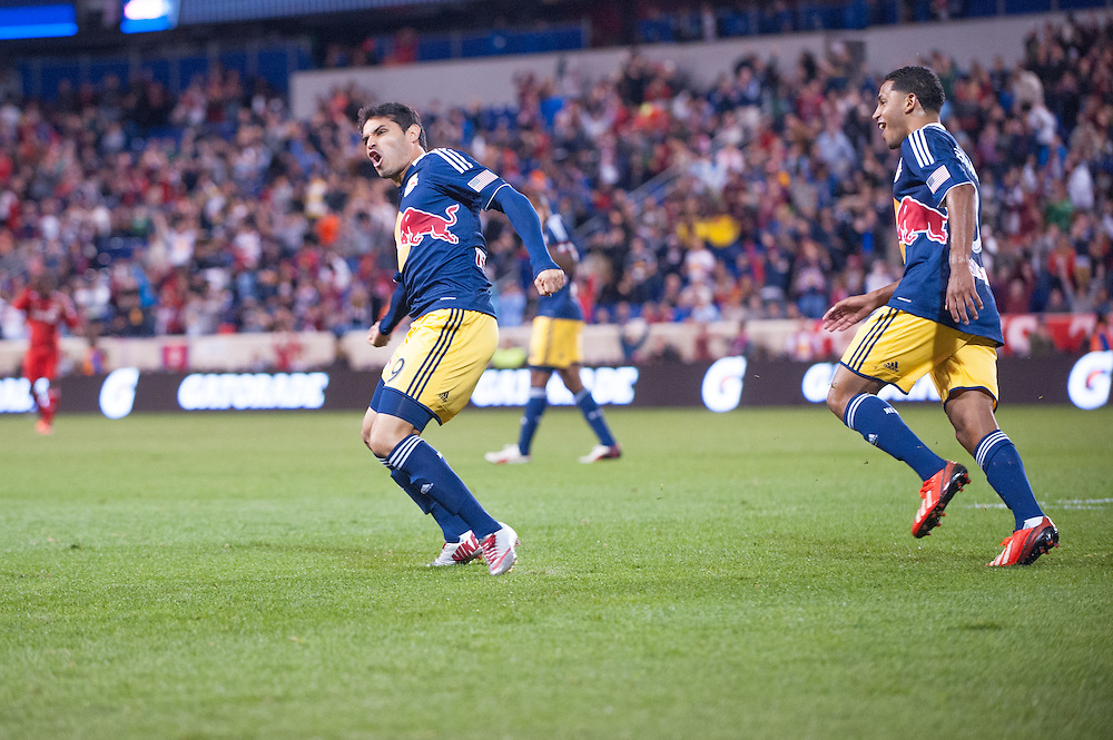 HARRISON, NJ - SEPTEMBER 14:  Fabian Espindola #9 of New York Red Bulls reacts after scoring a goal in the second half during the game against the Toronto FC at Red Bulls Arena on September 14, 2013. (Photo By: Rob Tringali)