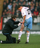 Ronny Johnsen (Villa) gets the cold spray for a thigh injury. Charlton Athletic v Aston Villa. 22/2/2003. Credit : Colorsport/Andrew Cowie.