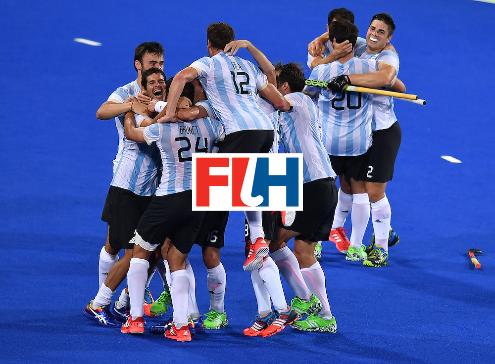 Argentina's players celebrate after winning the men's Gold medal field hockey Belgium vs Argentina match of the Rio 2016 Olympics Games at the Olympic Hockey Centre in Rio de Janeiro on August 18, 2016. / AFP / MANAN VATSYAYANA        (Photo credit should read MANAN VATSYAYANA/AFP/Getty Images)