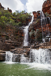 A waterfall flows into the Sale River in Doubtful Bay on the Kimberley coast of  Western Australia.