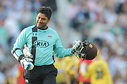 Surrey Batsman Kumar Sangakkara is caught off of the bowling of Hampshire T20 all-rounder Darren Sammy during the NatWest T20 Blast South Group match between Surrey County Cricket Club and Hampshire County Cricket Club at the Kia Oval, Kennington, United Kingdom on 9 June 2016. Photo by David Vokes.