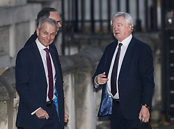 © Licensed to London News Pictures. 22/11/2017. London, UK. Brexit Secretary David Davis (R) talks with Justice Secretary David Lidington as he arrives in Downing Street for a pre-budget day cabinet meeting. Photo credit: Peter Macdiarmid/LNP