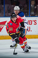 PENTICTON, CANADA - SEPTEMBER 8: Brandon Saigeon #46 of Edmonton Oilers back checks Spencer Foo #15 of Calgary Flames as he skates with the puck during first period on September 8, 2017 at the South Okanagan Event Centre in Penticton, British Columbia, Canada.  (Photo by Marissa Baecker/Shoot the Breeze)  *** Local Caption ***