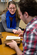Special Collections Librarian Miriam Intrator discusses ancient math manuscripts with Justin Chapian, a student enrolled in Ohio University Associate Professor Bob Klein's History of Mathematics class, during a special presentation at Alden Library on April 18, 2014. Photo by Lauren Pond.