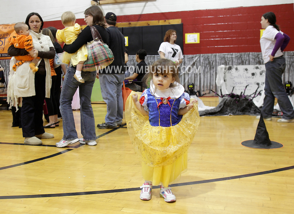 Middletown, New York - A young girl wearing a costume dress stands in the gymnasium during the Family Fall Festival at the Middletown YMCA on Oct. 23, 2010. ©Tom Bushey / The Image Works