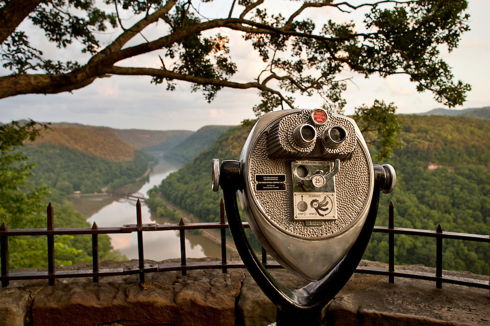 USA, West Virginia, Ansted, Coin-operated binoculars at viewpoint of New River from Hawk's Nest State Park at sunset on spring evening