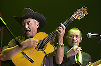 Cuban singers Eliades Ochoa, left, and Manuel Galvan sing during a concert performed at the Gran Teatro de la Habana, offered as a posthumous homage to Masters Ruben Gonzalez and Compay Segundo, Sunday September 19, 2004 in Havana, Cuba. (Photo/Cristobal Herrera)